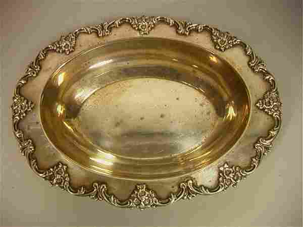 J.E. CALDWELL Oval Bowl with Floral Rim. Deep Bow