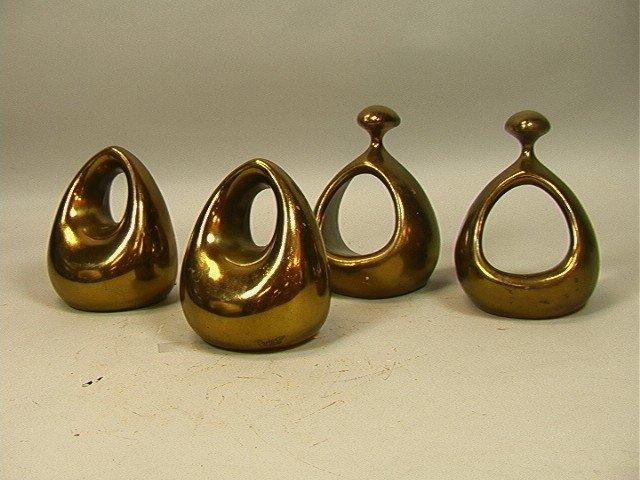 24: 2 pair Ben Seibel Bookends.  Jenfred-ware. Brass
