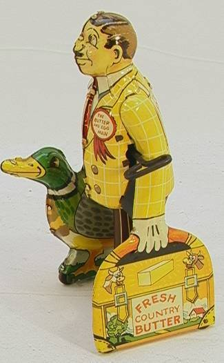 2: Vintage Tin Windup Butter and Egg Man with Duck    D