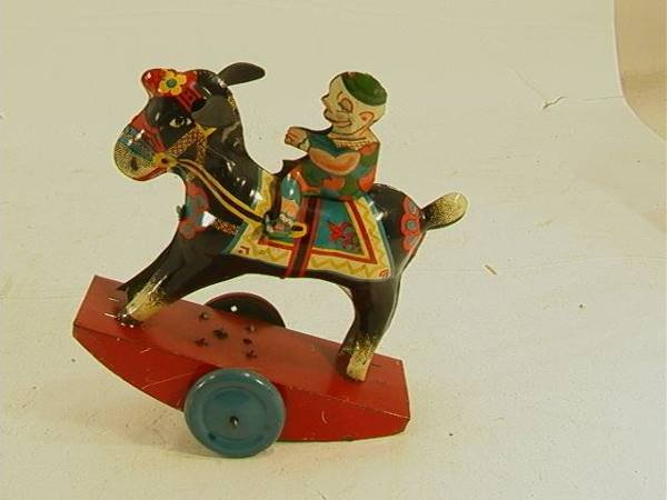 5: Vintage Tin windup Bucking Horse with Clown on Back
