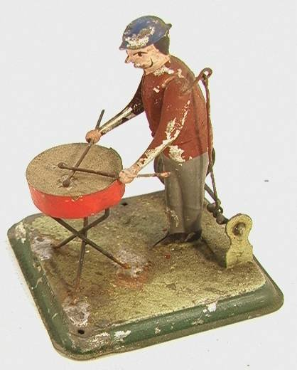 13: Vintage German Tin Mechanical Drummer  Pully driven