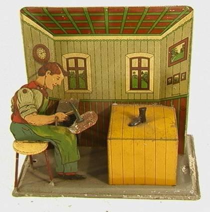 14: German YK Tin Cobbler Shoemaker Mechanical Toy  Win