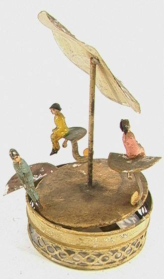 20: German Tin 3 Figure Merry Go Round with Umbrella pu