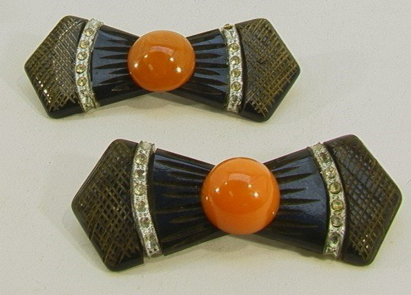 206: Pr Bakelite Bow Pins (2) Rhinestone. Carved brown