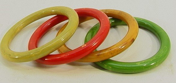 209: Lot 4 Thin Bakelite bangle Bracelets. Green, Red,