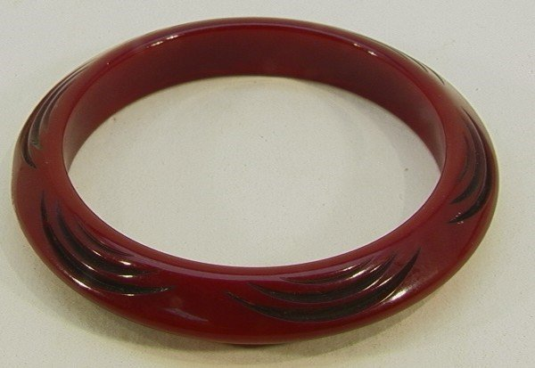 211: Burgundy Carved Bakelite Bangle Bracelet. Carved t
