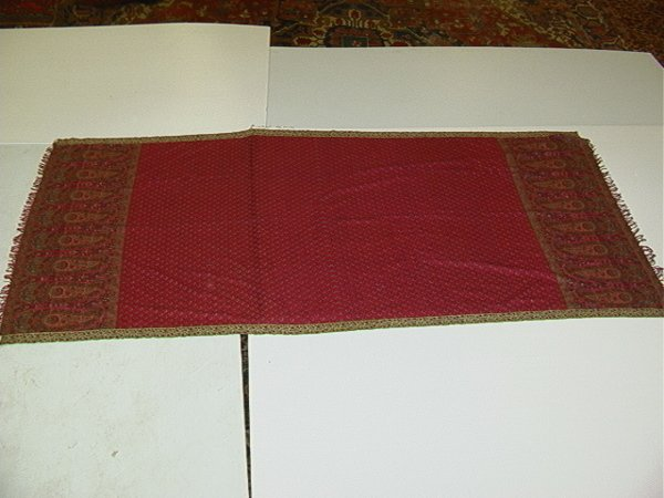 538: Woven paisley coverlet with open red field and pai