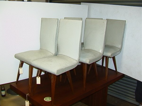 1219: Six 50s Modern Tapered Leg Chairs.  Gray leather