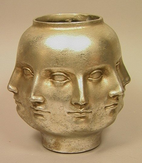 22: PIERO FORNASETTI style Multi Face Vase. Silver Le