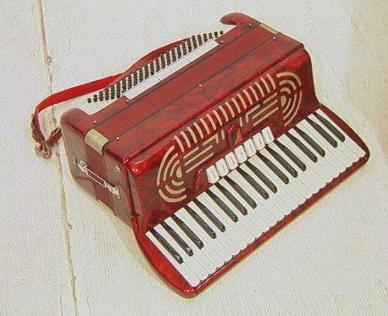 23: GUERRA Accordion. Red Marbled Celluloid Case. In