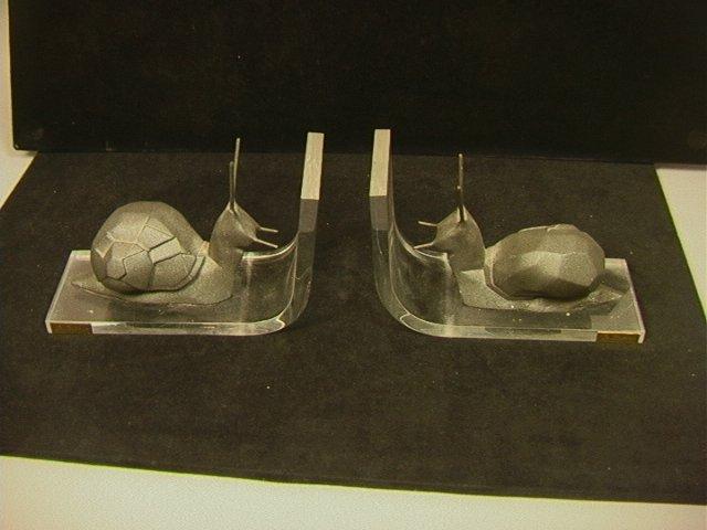 Pr Snail Lucite Bookends. P. BORRAS. Metallic sna