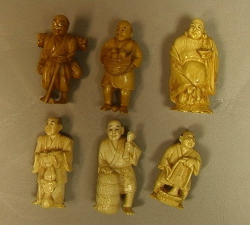 Lot 6 Ivory Carved Figures. One man with basket o