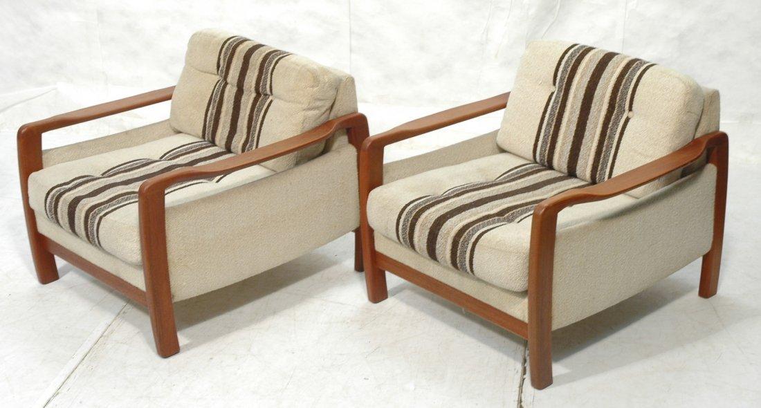 Pair Danish Modern Teak Lounge Chairs. Wide arms.