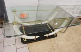 Decorator Faux Tusk base Glass Top Dining Table.