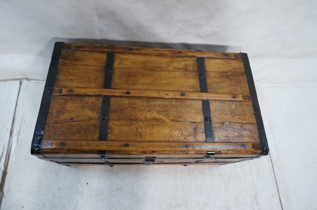 Antique wooden chest. Black metal straps. Leather - 2