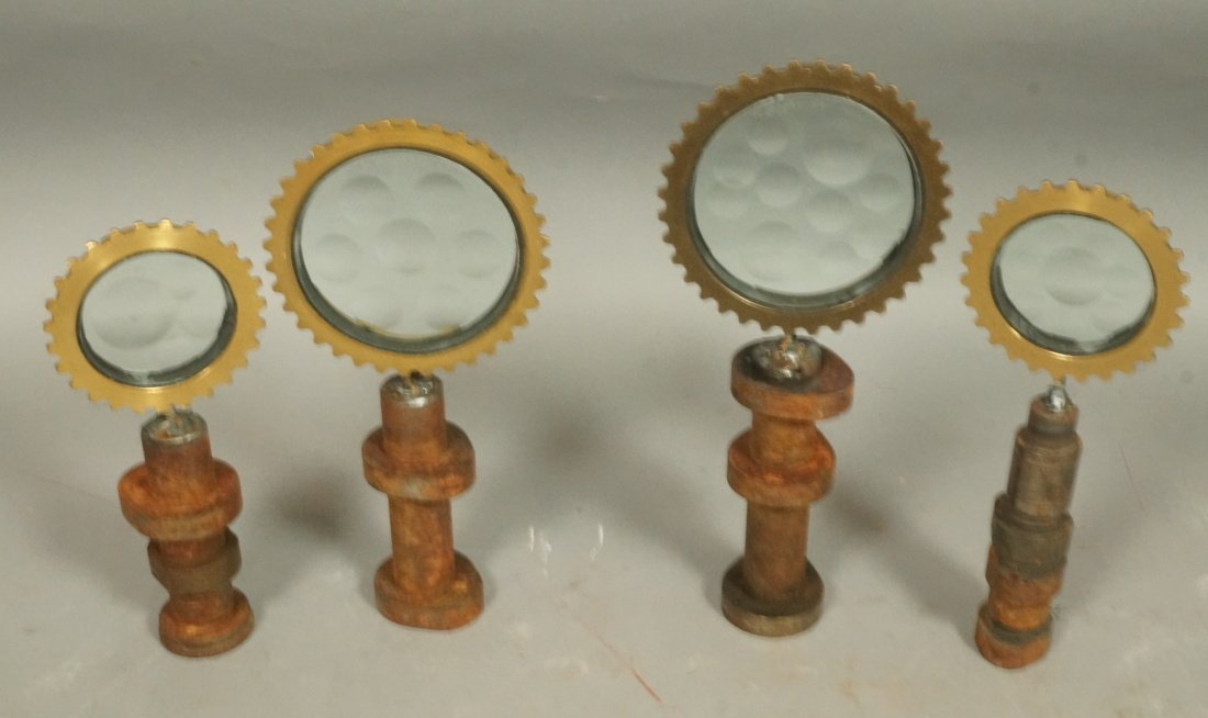 Set 4 Magiscope Sculptures with brass frames. Ind