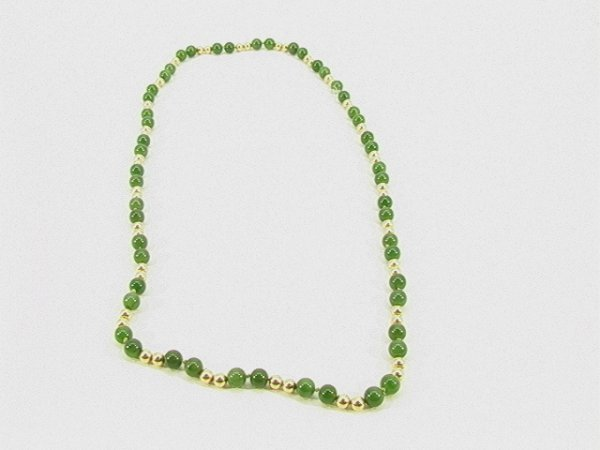17: Jade 14K Gold Bead Necklace. Designed with 2 gold b