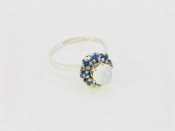19: 14K Gold Opal Blue stone Ring.    Dimensions:     C