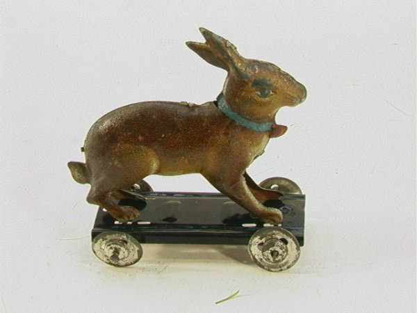 710: German tin bunny pull toy marked with horse pullin