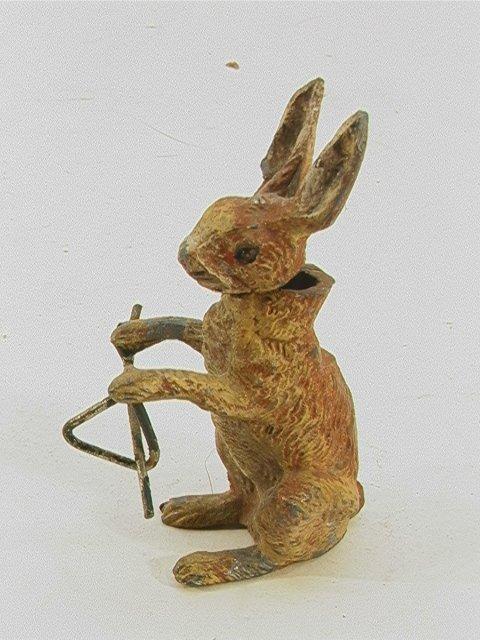 712: white metal rabbit nodder with dinner bell Vintage