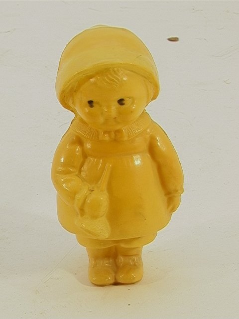 713: Celluloid figure baby rattle    Dimensions:  H: 3