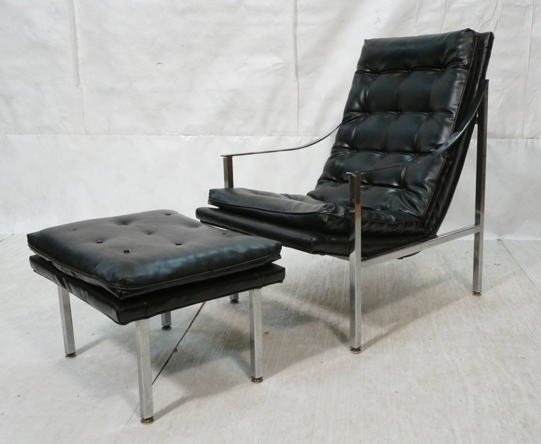 Black vinyl Lounge Chair & Ottoman. Chrome Frame.