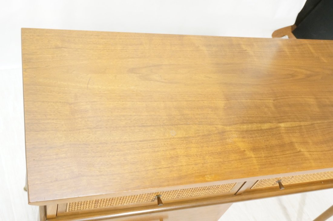 Modernist Walnut Desk. Two Caned front drawers. M - 4