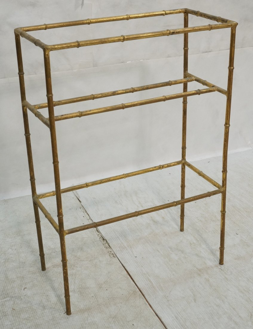 Gilt metal faux bamboo towel rack. Gold painted m