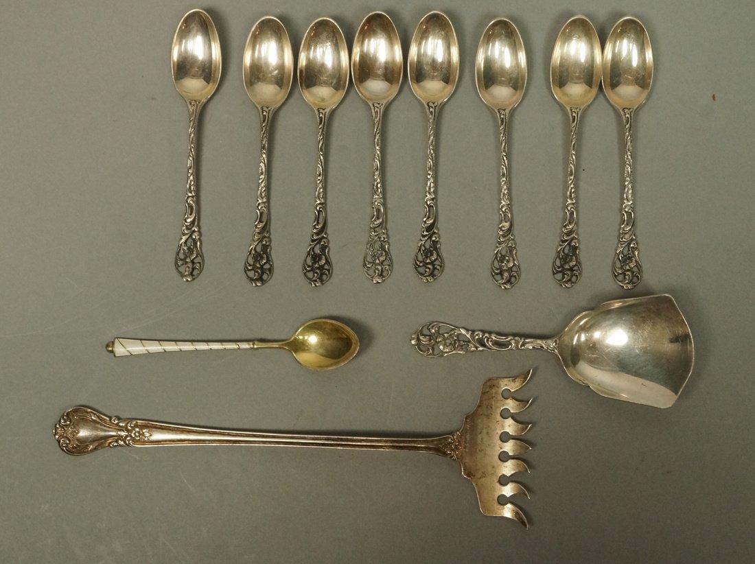 11pc Silver Items. 8 demitasse spoons marked zLz.