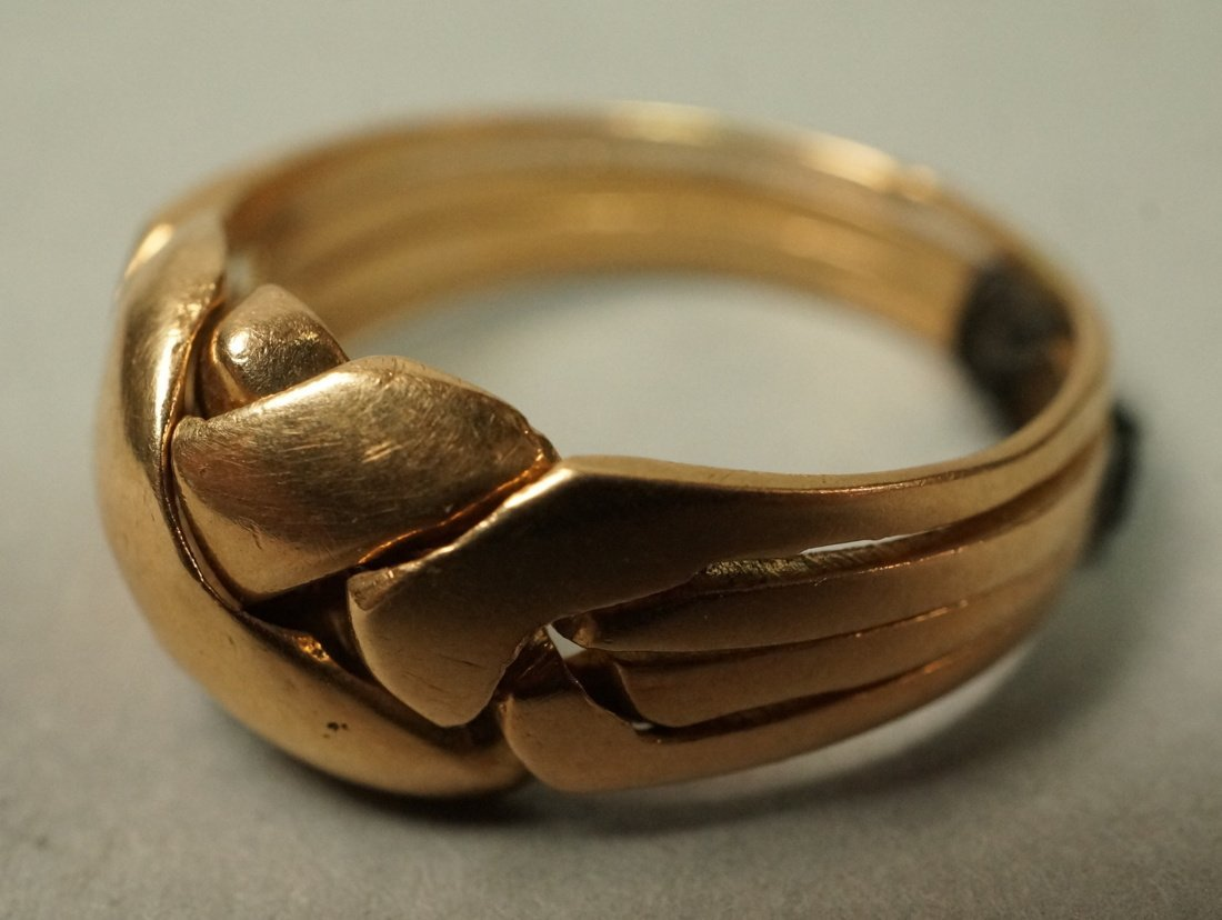 14K Gold Puzzle Ring.  4 interlocking sections.
