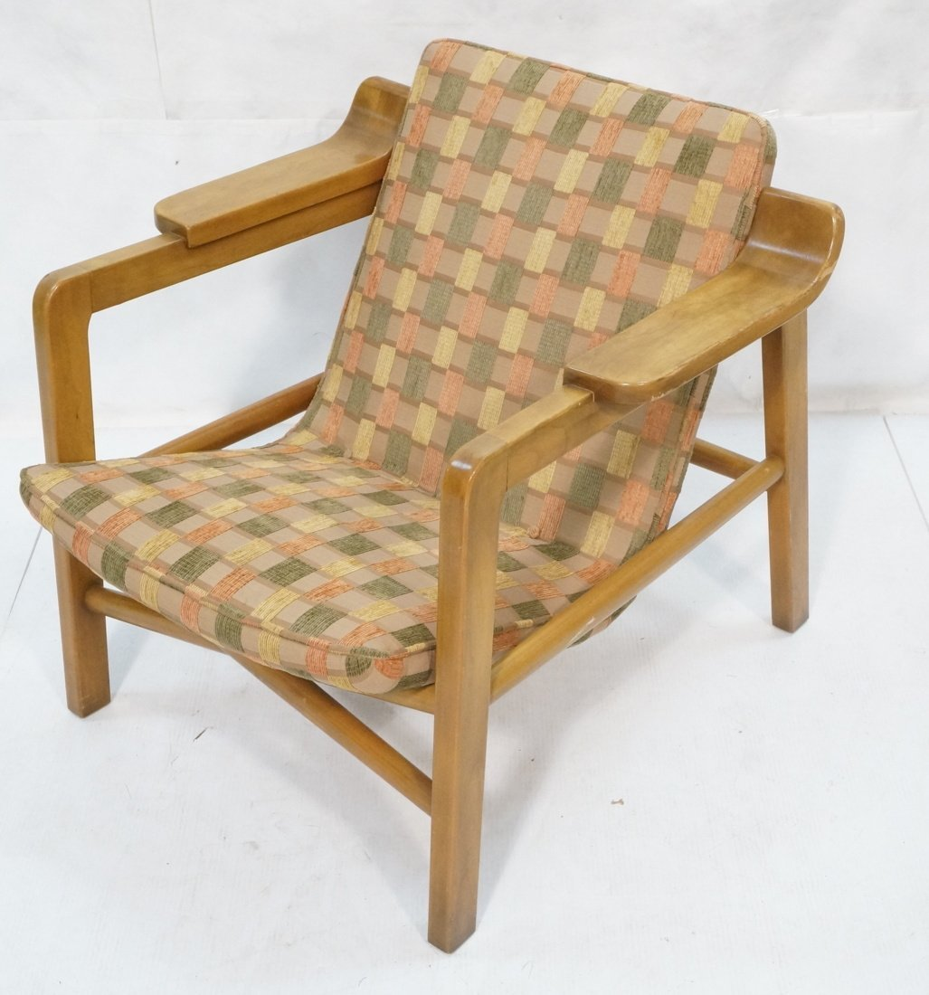 Modern Lounge Chair. Wood frame with arm rests. F
