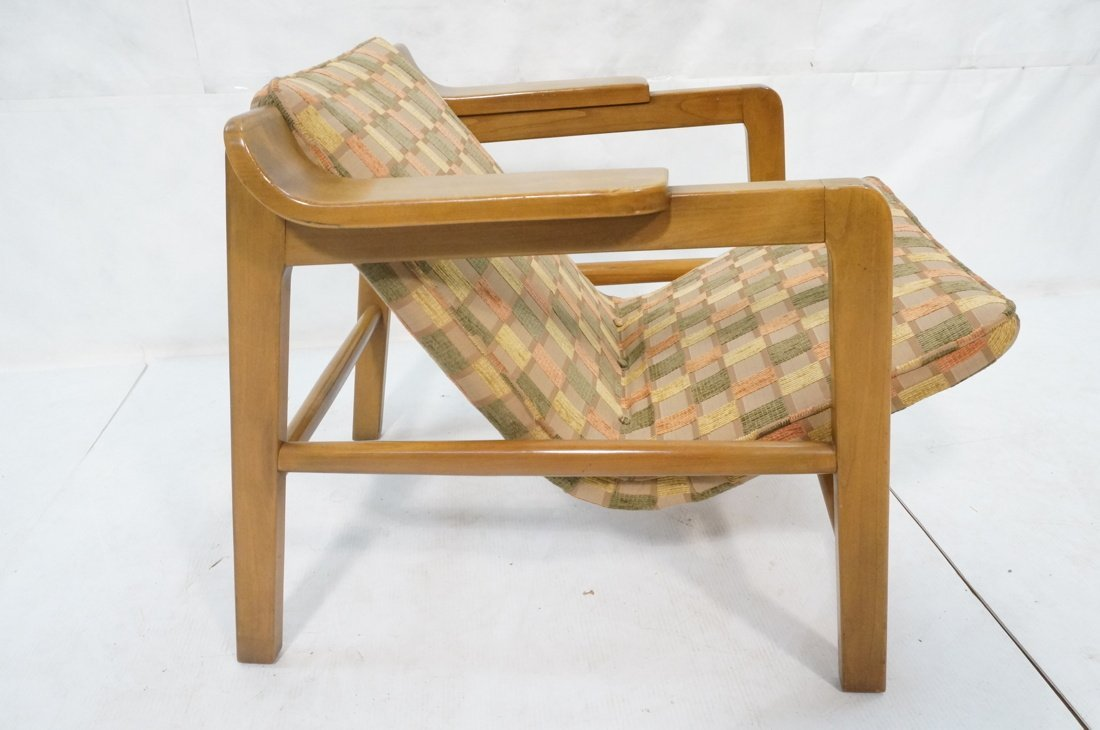 Modern Lounge Chair. Wood frame with arm rests. F - 7