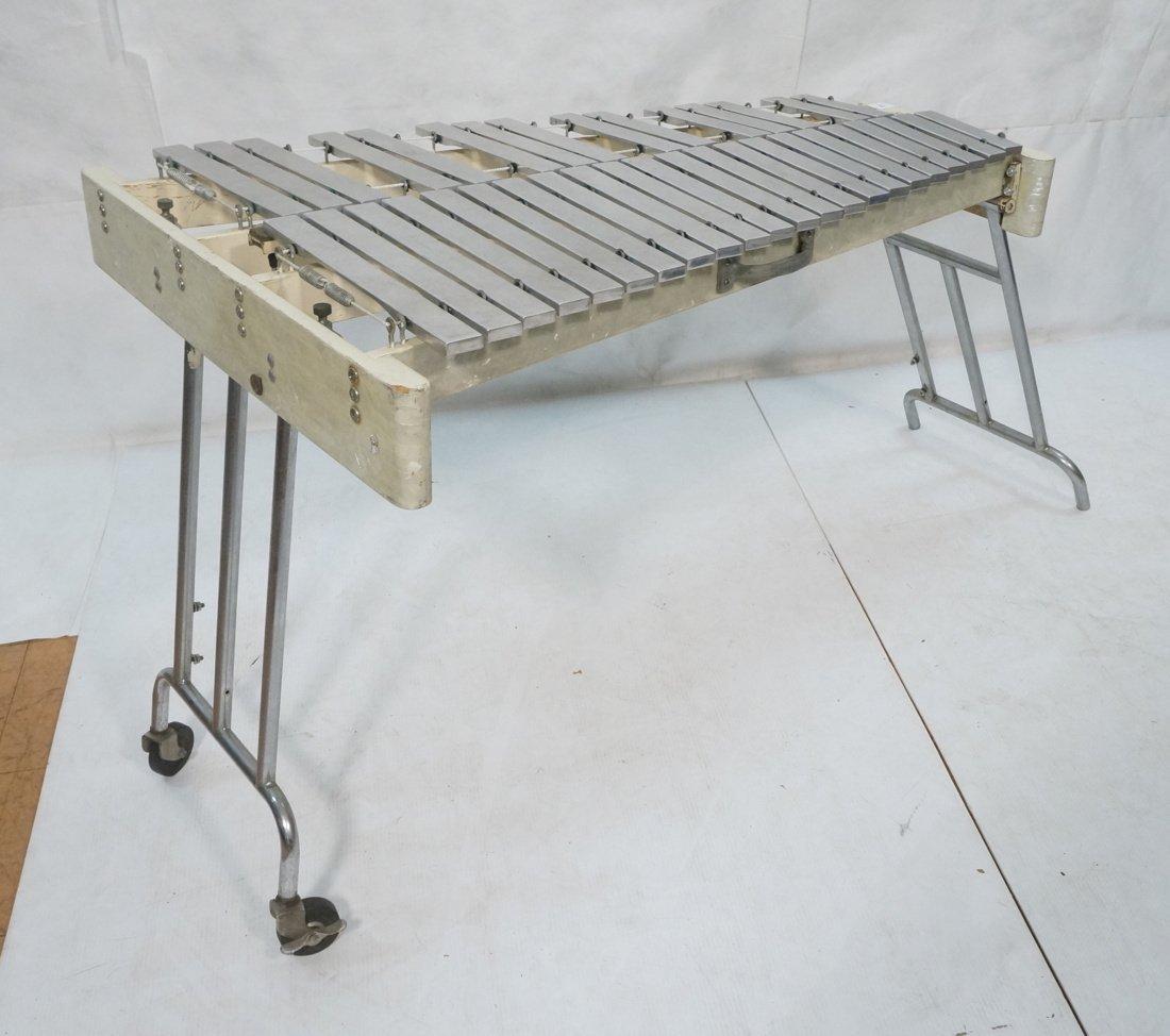 Jen C0. Aluminum oversized xylophone. Folding leg