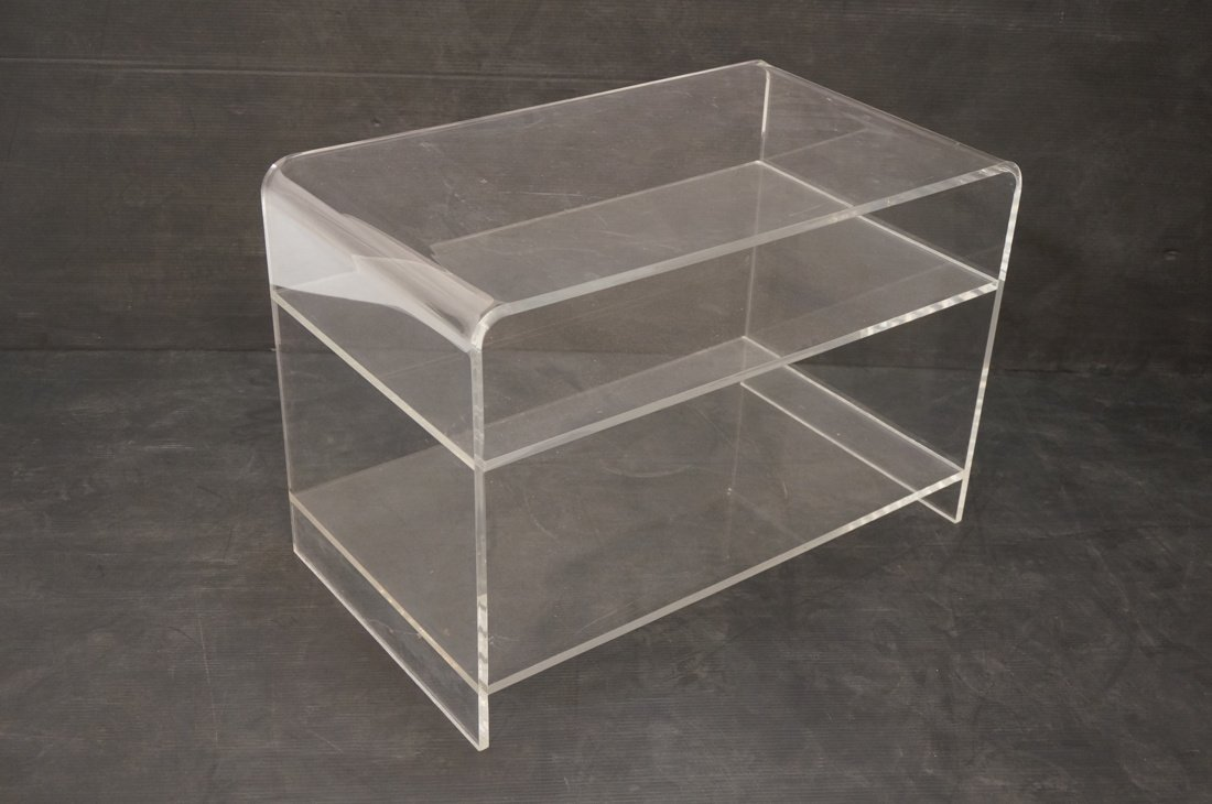 Molded Lucite Side Table. Two lower shelves