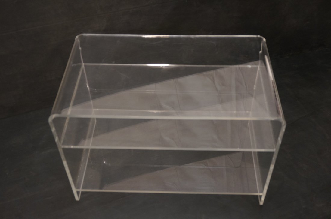 Molded Lucite Side Table. Two lower shelves - 4