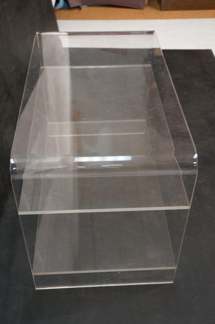 Molded Lucite Side Table. Two lower shelves - 7