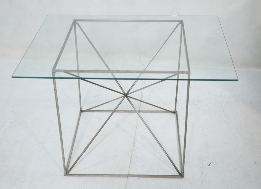 Glass Top Modernist Table. Thin silver metal cors