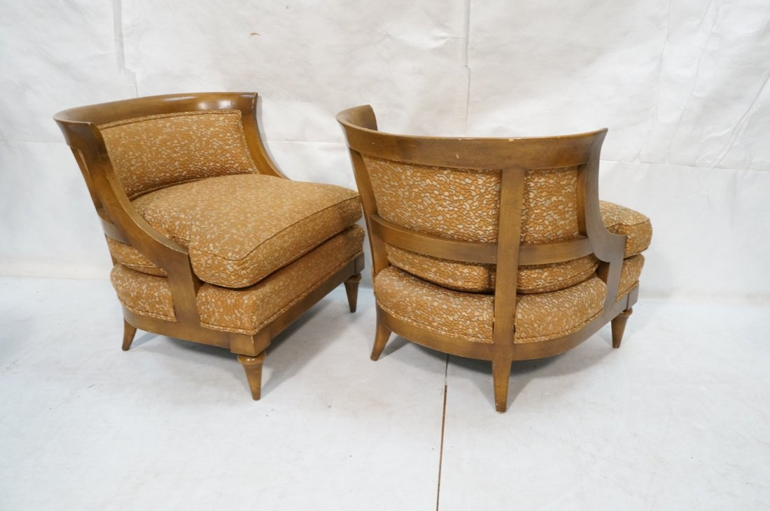 Pr Low Lounge Chairs. Bowed backs. Wood frames. P - 7