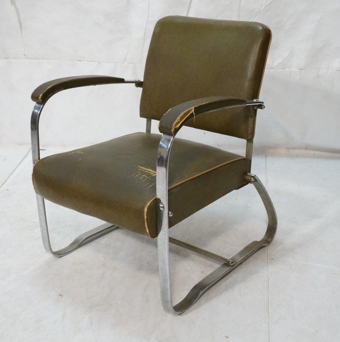 Green Vinyl Modernist Lounge Chair. Thin metal tu