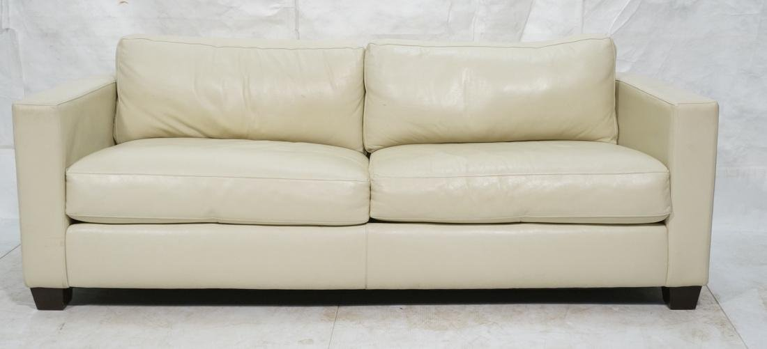 Off White Leather Modern Sofa. Wide arms with rou