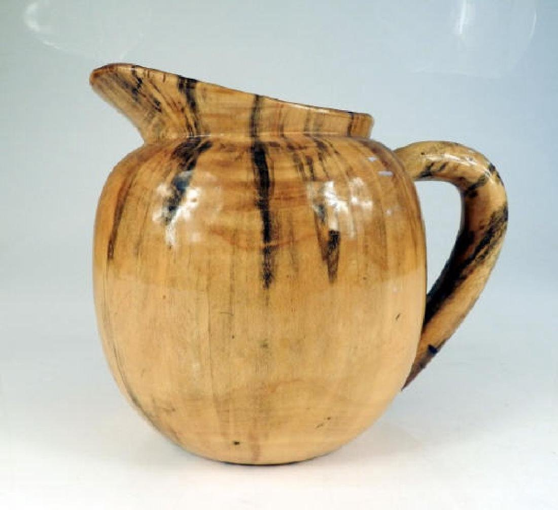 Folk Art Burl Wood Pitcher A burl wood carved pitcher,