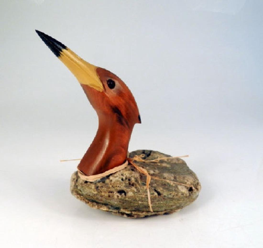 Folk Art Waterfowl A wooden and stone sculpture of a