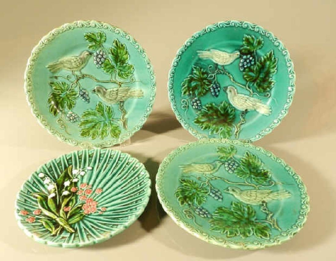 Four Green Majolica Plates