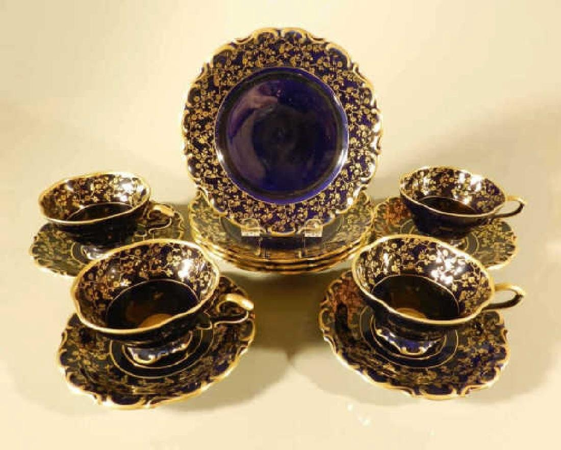 Four Cobalt Blue & Gilt Cups, Saucers & Plates