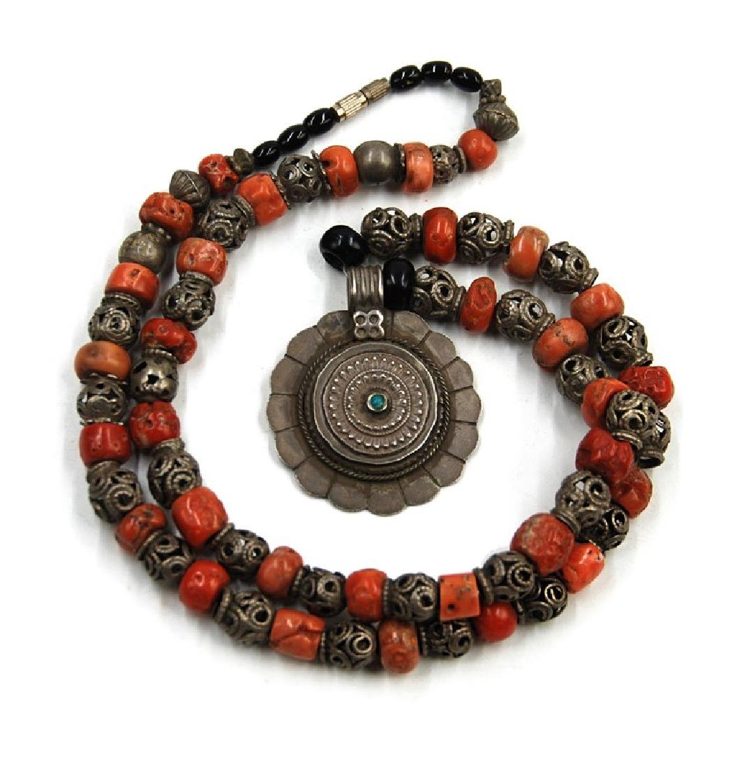 A SILVER NECKLACE WITH CORAL BEADS