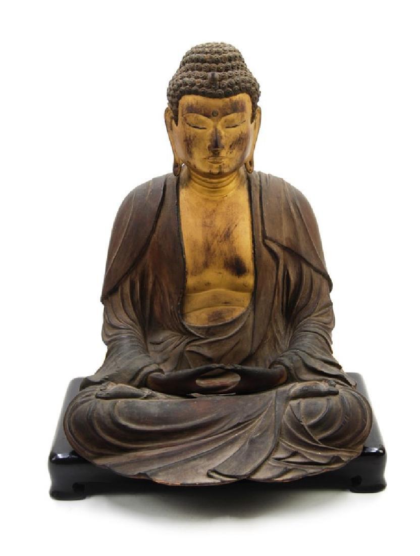 A JAPANESE CARVED GILT WOOD SEATED BUDDHA, EDO DYNASTY