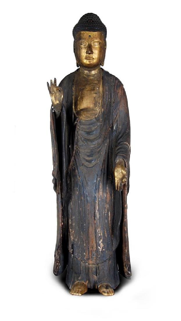 A LARGE CARVED GILT WOOD STANDING BUDDHA,EDO