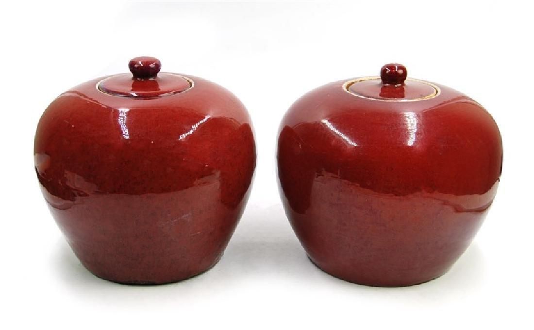 PAIR RED LIDDED JARS
