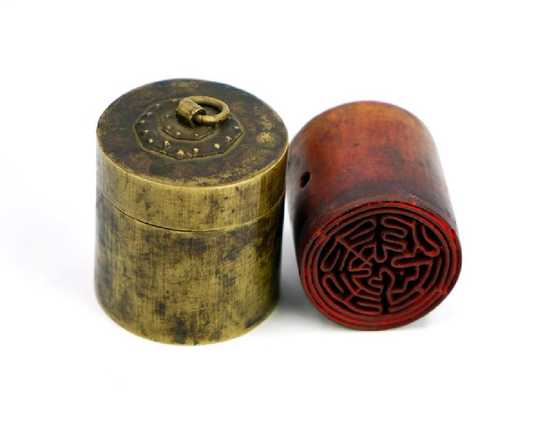 CARVED STAMP IN CANISTER - 2