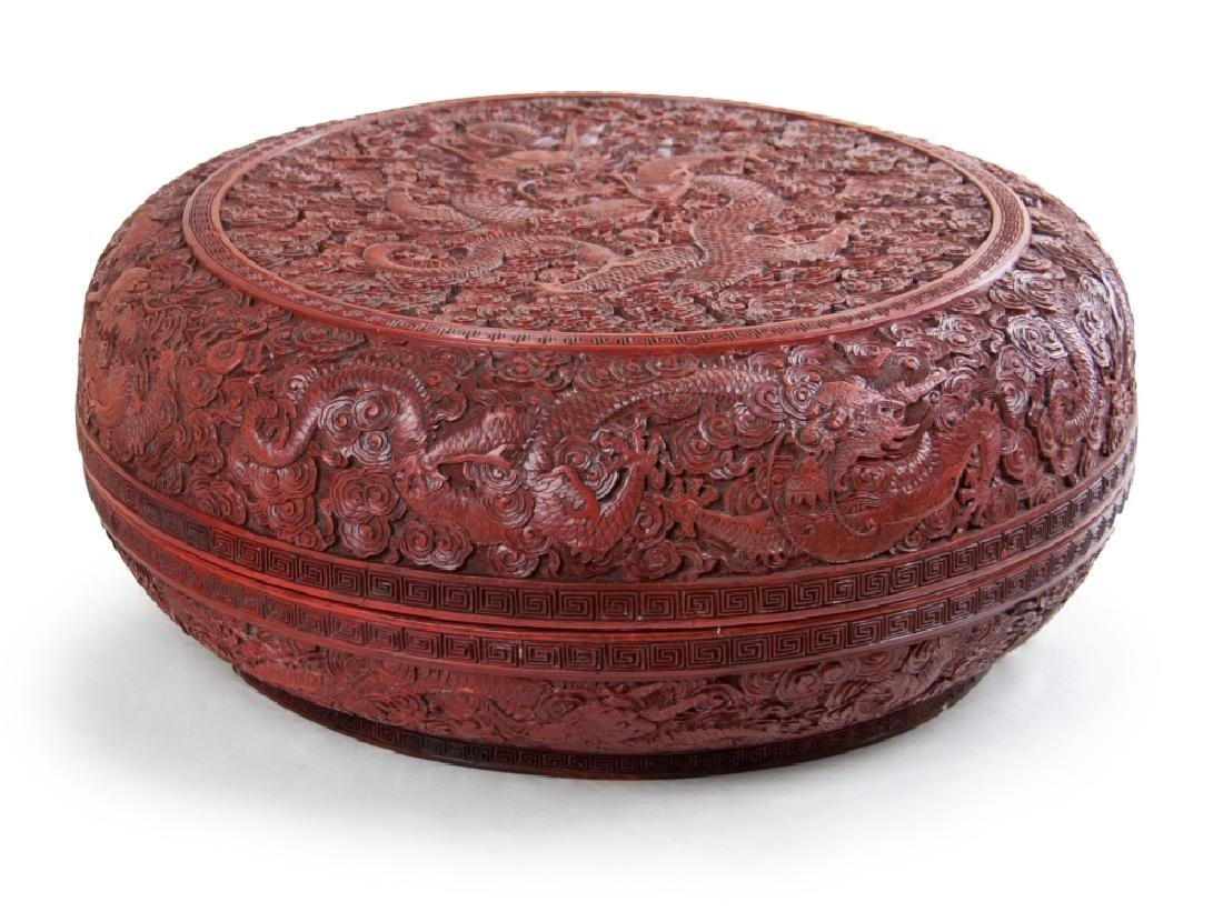 A LARGE CARVED CINNABAR LACQUER BOX NINE DRAGONS